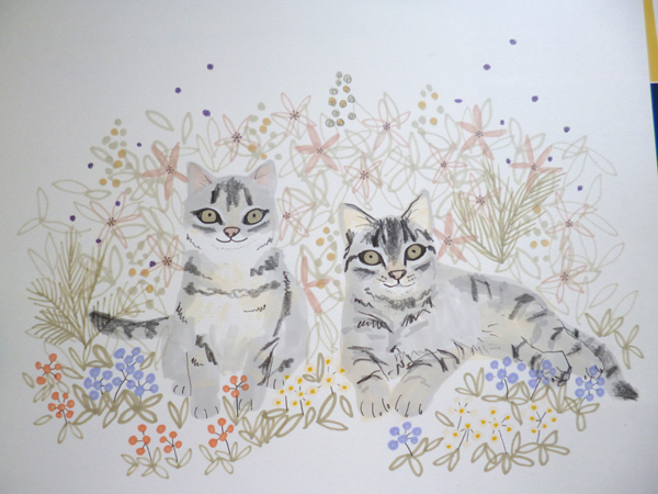 The petals plants and leaves are added all around the cats