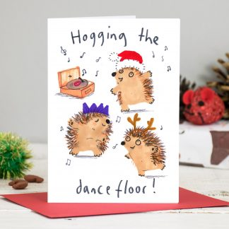 Hogging the dance floor - hedgehogs dancing with christmas hats christmas card