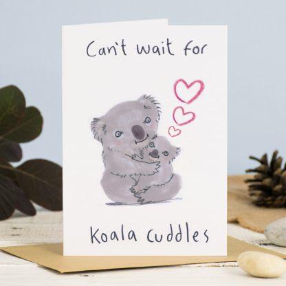 koala cuddles new baby